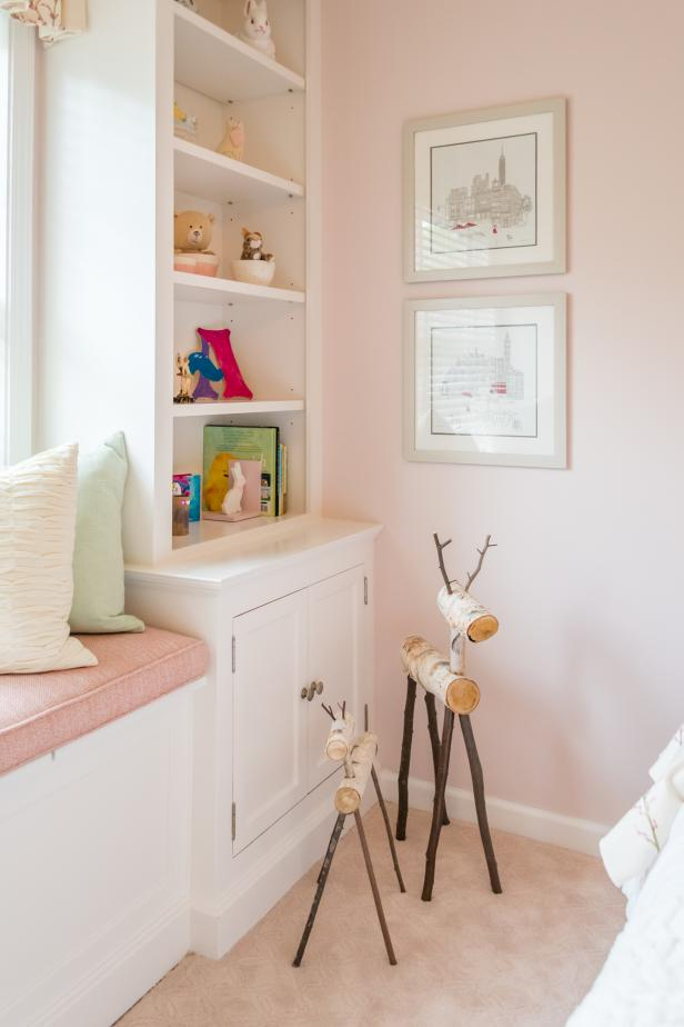 Pink and White Little Girl's Room with Built-In Shelving