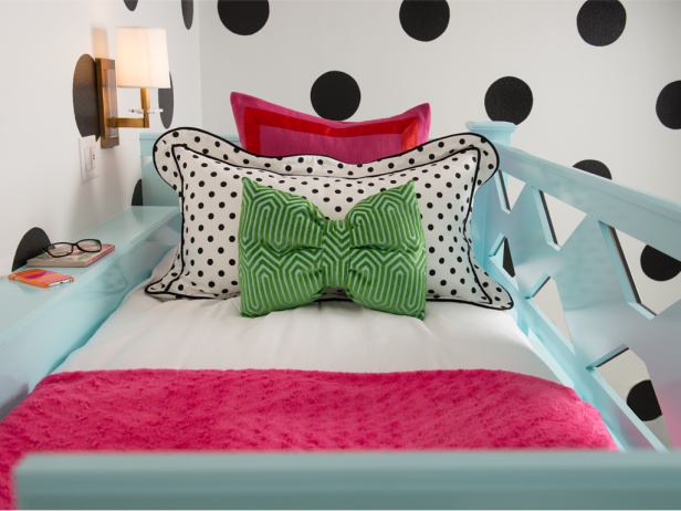 Blue Lofted Bed With Black and White Polka Dot, Pink and Green Pillows