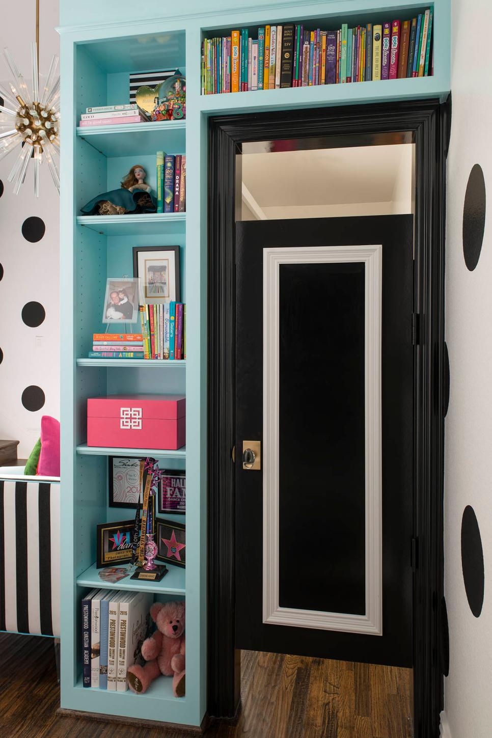 Light Blue Bookshelves With Black and White Door for Dressing Area