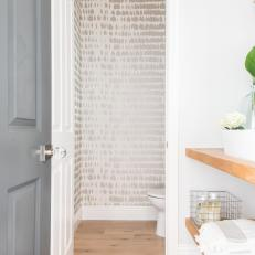 Bright White Bathroom With Wallpapered Accent Wall