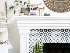 Decorative Tile Fireplace Surround and White Mantel Finished With Potted Plants and Metallic Mirror