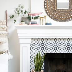 Decorative Tile Fireplace Surround And White Mantel Finished With Potted Plantetallic Mirror