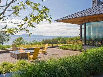 Stone Terrace With Firepit and Lake View