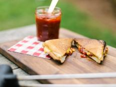 Half calzone, half grilled cheese, this easy campfire recipe is all delicious.