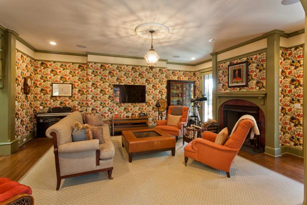 Traditional Living Room With Orange Chairs, Colorful Wallpaper
