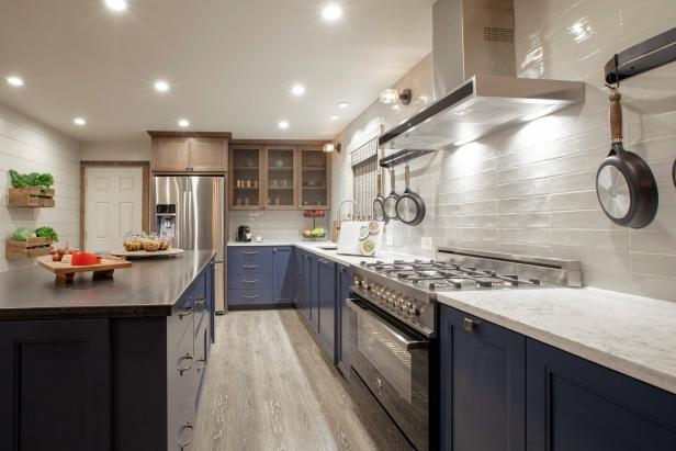 Blue Kitchen Cabinets With Marble Countertop and White Tile Backsplash