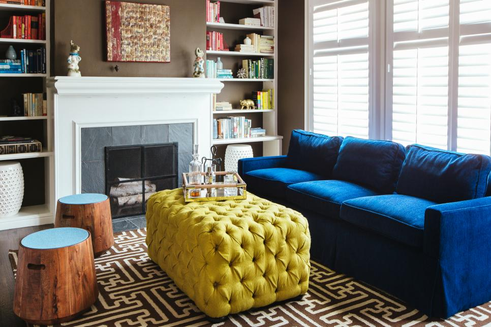 Contemporary Living Room With Royal Blue Sofa Tufted Yellow Coffee Table And Wood Stools Hgtv