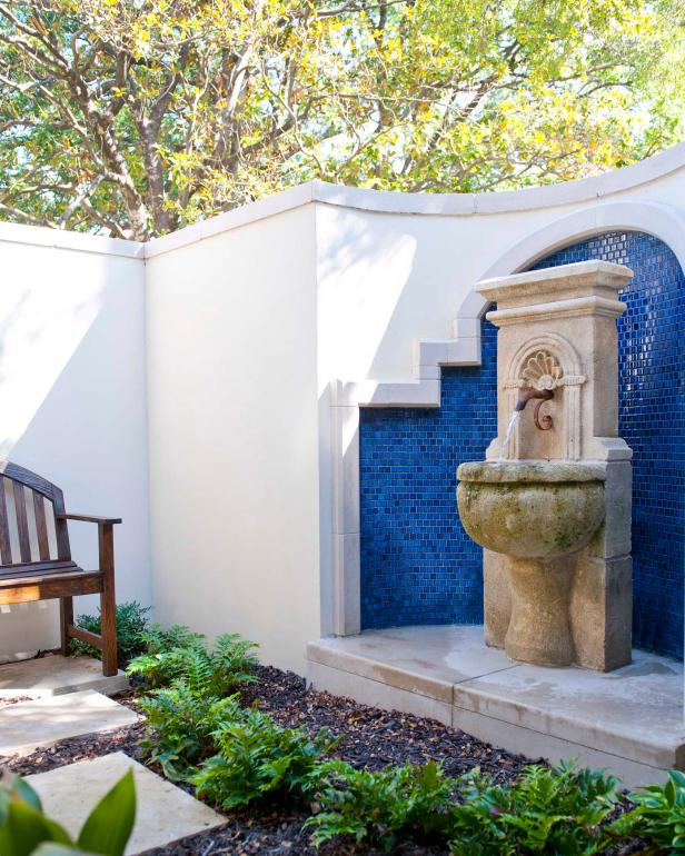 Spanish-Inspired Courtyard With Water Fountain, Blue Mexican Tiles