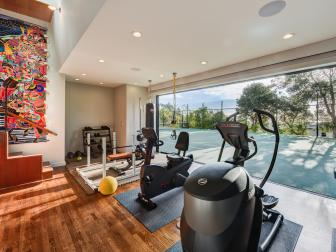 Gym with Multi-Glass Sliding Door Opening Onto Tennis Courts