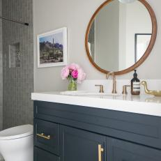 Gray and White Bathroom With Round Mirror
