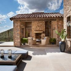Stone Mediterranean Outdoor Living Room and Cactus