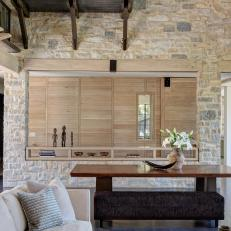 Contemporary Rustic Living Room With Stone Wall