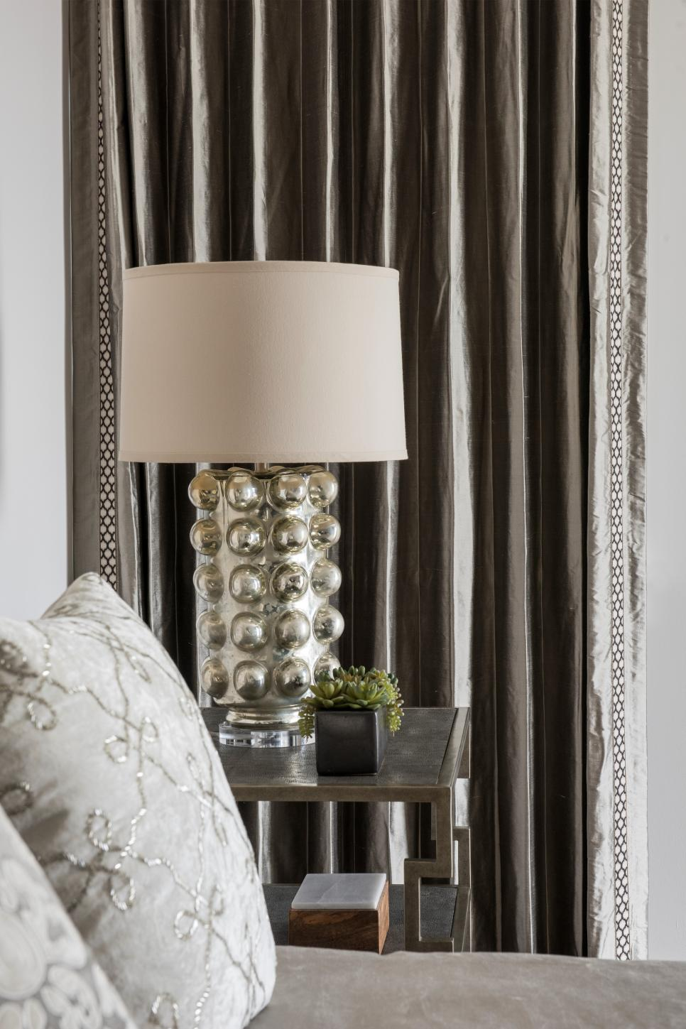 Gray Living Room With Metallic Table Lamp and Satin Curtains