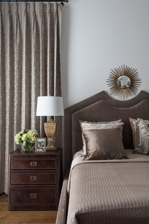 taupe transitional bedroom with metal starburst mirror  hgtv