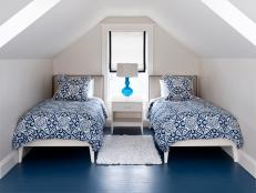 Contemporary Attic Bedroom With Double Beds