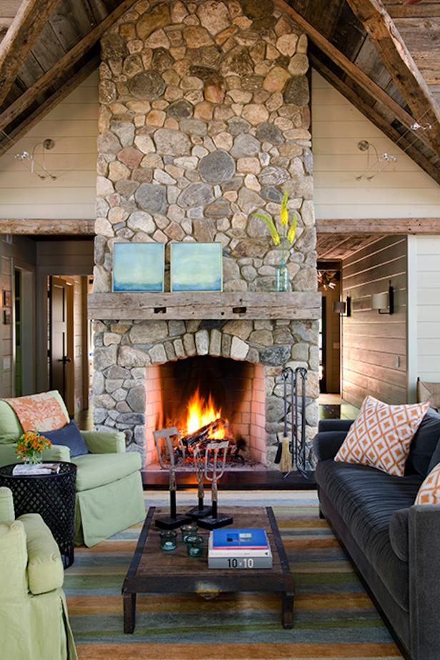Tall, Rustic Fireplace in Cozy Living Room
