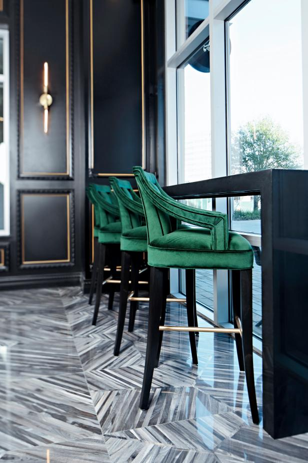 Black Art Deco Bakery With Emerald Green Barstools & Black Countertop
