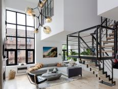 White Urban Living Room With Staircase
