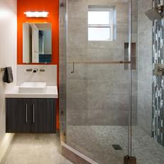 Bright Red Accent Wall in Modern Bathroom With Glass Door Shower and Floating Vanity