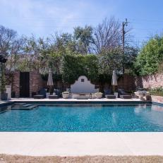 Backyard With Pool and Brick Walls