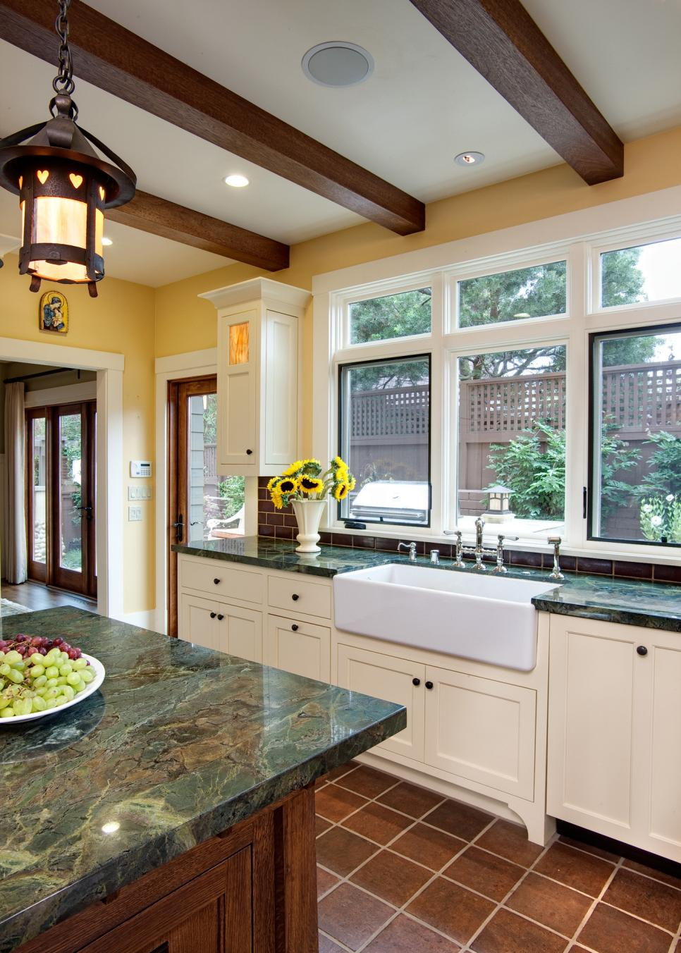 Forest Green Marble Countertop Large White Farmhouse Sink And Exposed Wood Beams In Craftsman Kitchen Hgtv