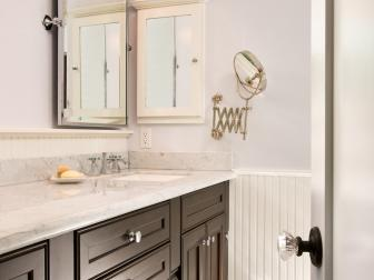 Modern Cabinets and Light Fixture Add Modernity to Traditional Bathroom