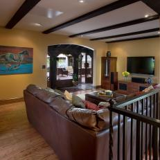 Comfy, Mediterranean Living Room Features Exposed Beam Ceiling