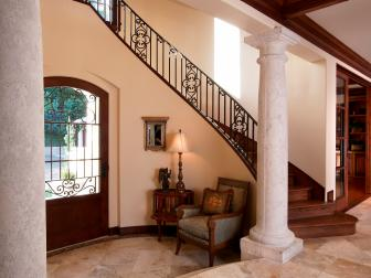 Open Traditional Foyer With Textured Column Finish, Marble Tile Floor and Large Glass Paneled Front Door