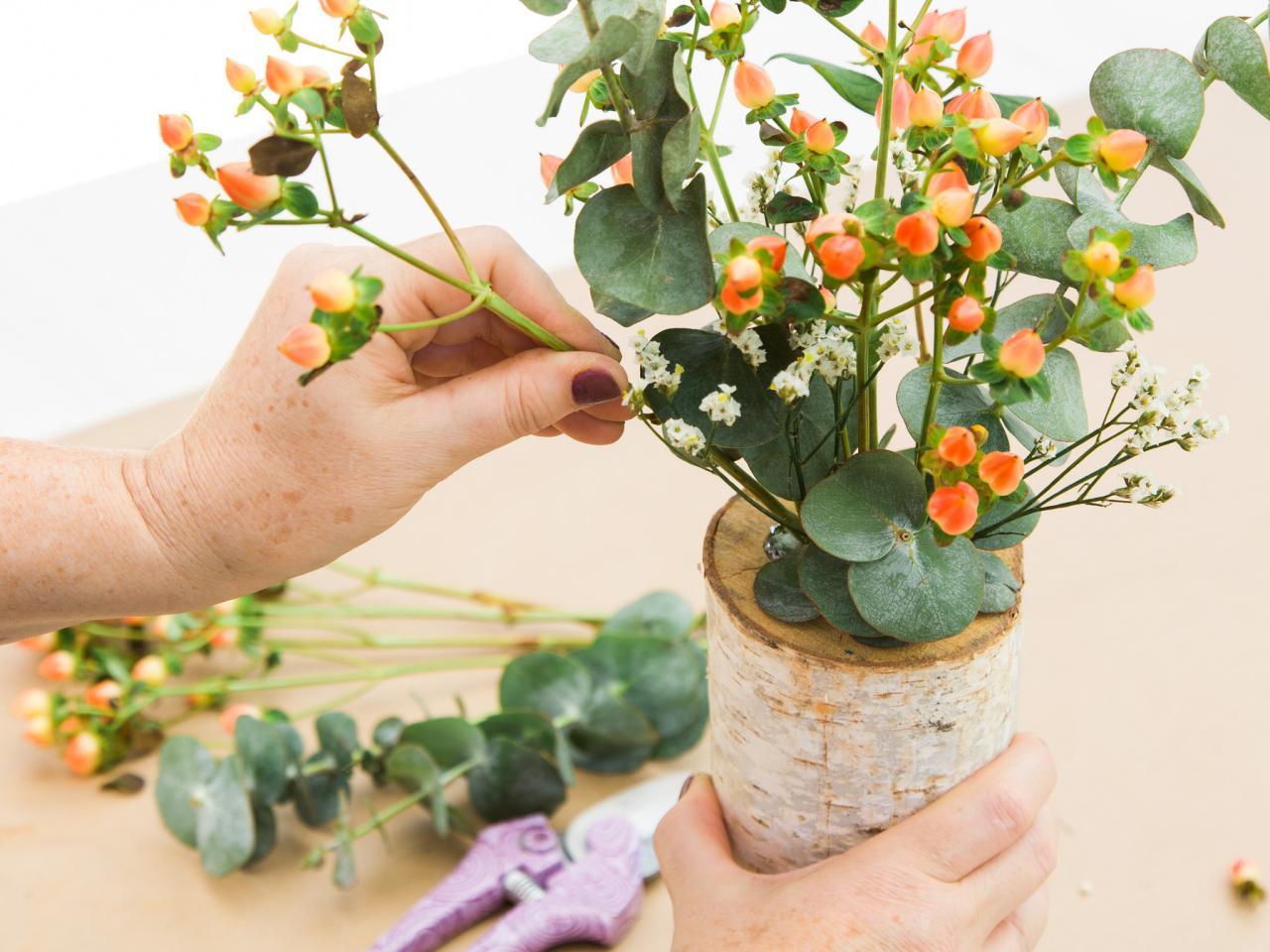 Diy tree stump vase filled with flowers hgtv arrange flowers floridaeventfo Images