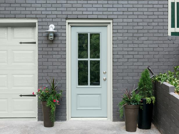 Exterior Trim in Muted Beach Tones and Faded Aqua