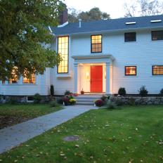 Classic Colonial Home With White Clapboard Siding and Red Front Door