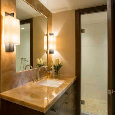 Custom Walnut Door Hides Shower In Guest Powder Room