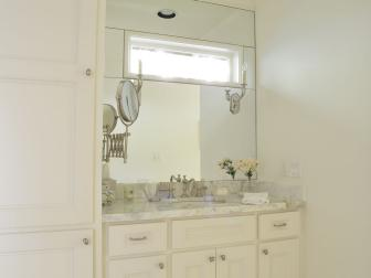 White Bathroom Walls Reflect Natural Light in Bathroom