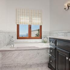 French Country Bathroom With Marble Bathtub