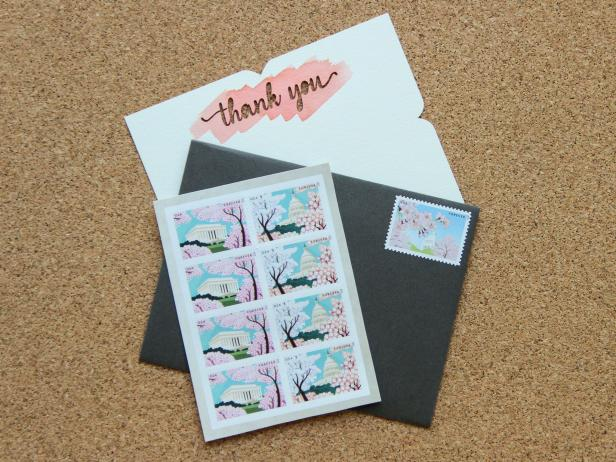 Stamps, a thank you note, and an envelope