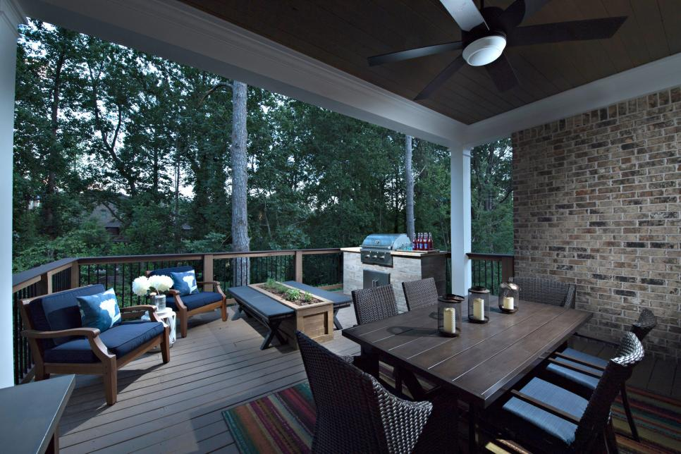 Transitional Covered Deck with Outdoor Dining Table and Built-in Grill