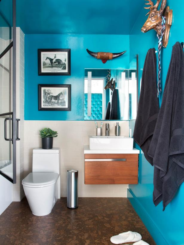 Modern Small Bathroom With Bold Teal Walls, Floating Vanity And Animal Wall  Decor