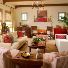 Neutral Contemporary Living Room with Warm, Red Accent Pieces
