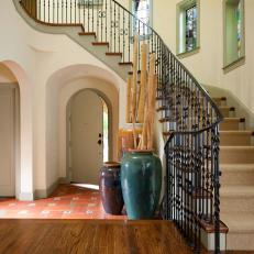 Staircase From Second Floor Leads Into Home's Foyer