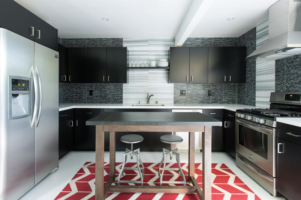 Black and White Kitchen with Red Area Rug