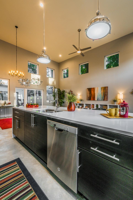 stylish black cabinets create functional kitchen island  hgtv
