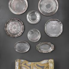 Vintage Serving Trays Create Focal Point in Charcoal Dining Room