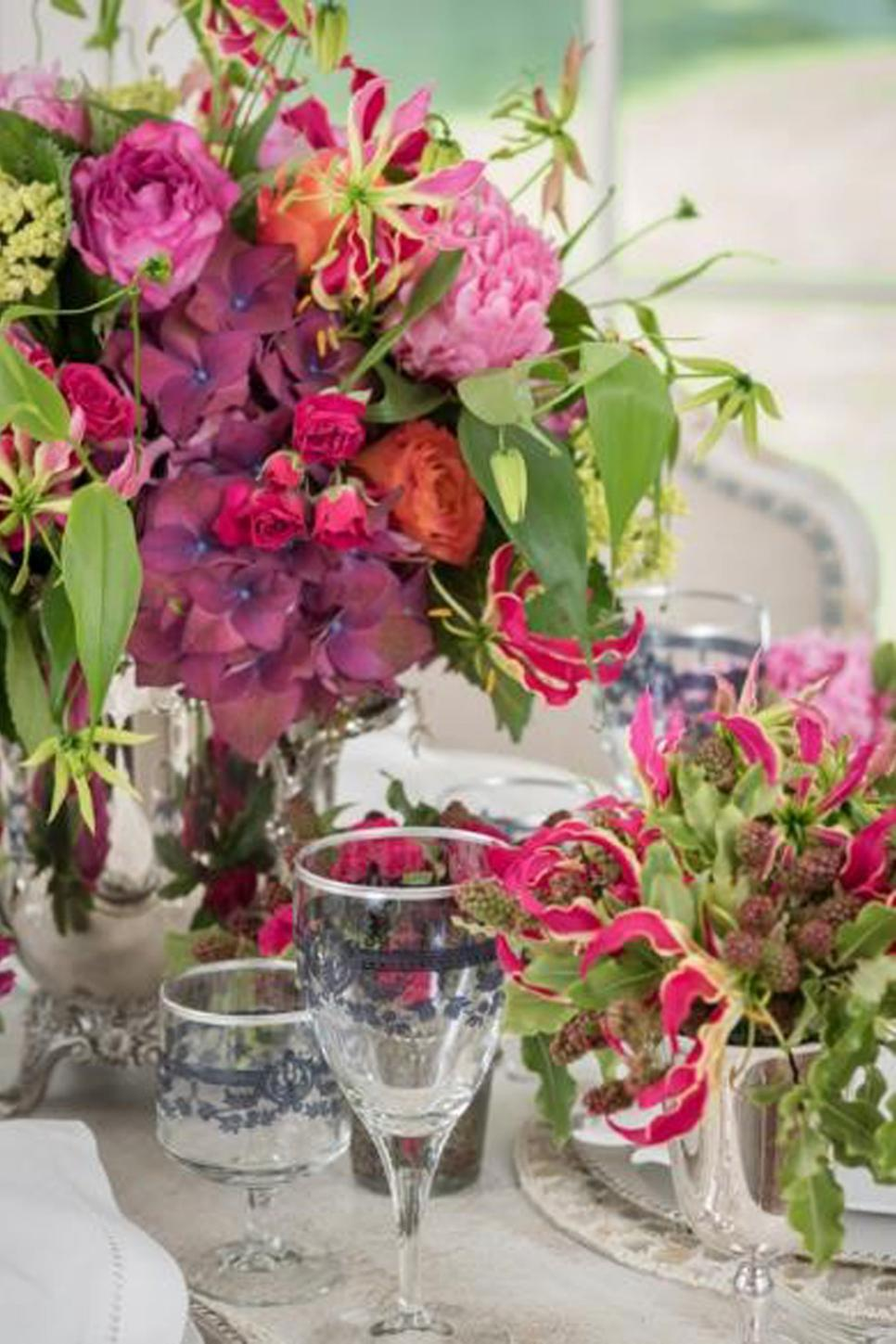 Pink and Orange Tabletop Floral Arrangements and Crystal Stemware