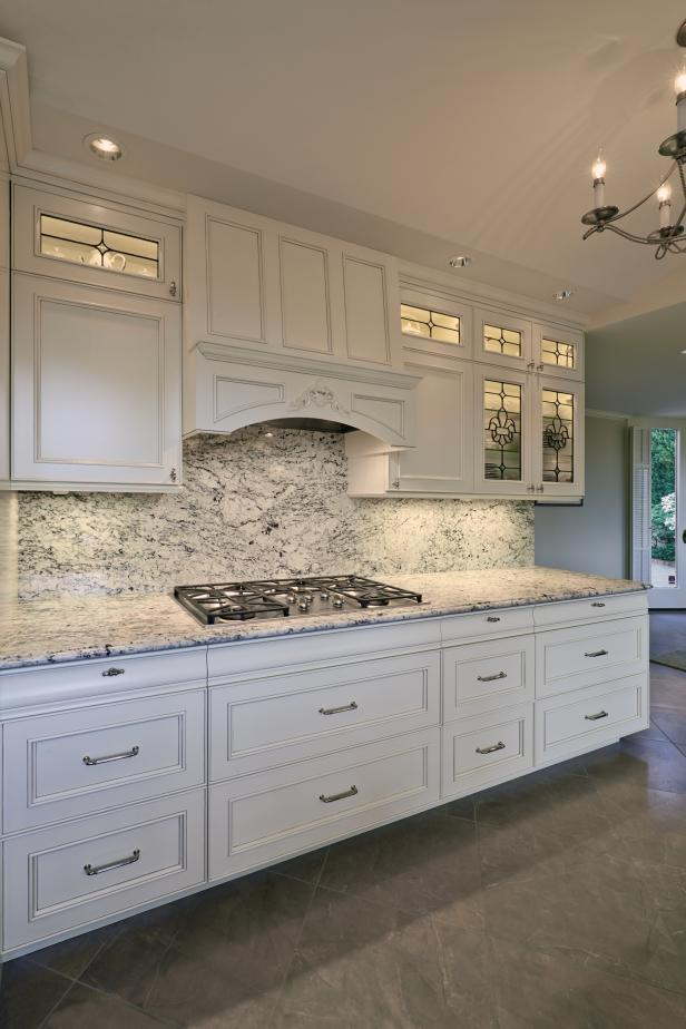 Light Airy Kitchen with Leaded Glass-front Cabinets and Under Cabinet Lighting