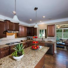 Superieur Dark Wood Kitchen With Tan Marble Countertops And Light Colored Tile  Backsplash