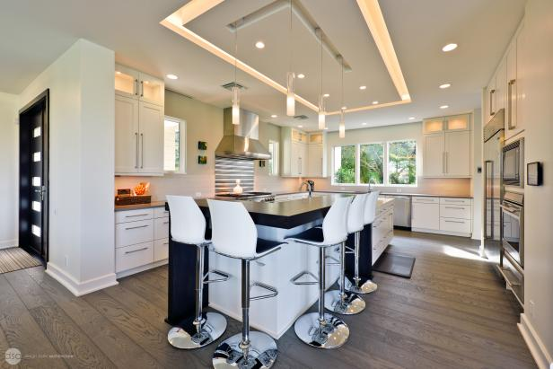 White Contemporary Open Plan Kitchen With Wood Floors