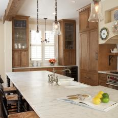 Rustic Kitchen with Built-in Cabinets, Pendant Lights, Wood Beam and Island