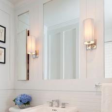 White Modern Bathroom with Horizontal Beadboard and Mirrors