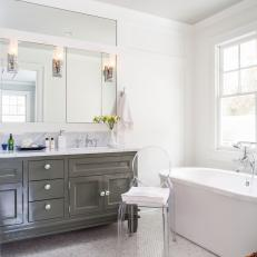 Contemporary White and Gray Bathroom with Oval Freestanding Tub and Ghost Chair
