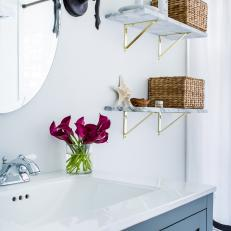 Contemporary White and Blue Bathroom with White Marble Shelves and Baskets